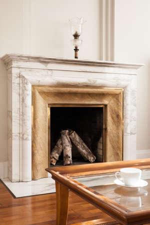 fireside: Designed marble fireplace in luxury living room