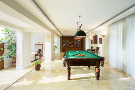 parlour games: Billiard table in luxury drawing room
