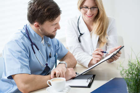 consulting room: Consulting a difficult case at a doctors room Stock Photo