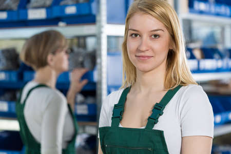 factory line: Portrait of young female beautiful factory worker Stock Photo
