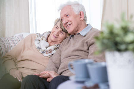 Image of aged couple dating at home
