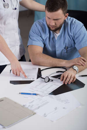 summons: Young male physician and summons for medical mistake Stock Photo