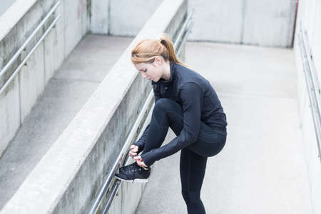 lacing sneakers: Runner has a break from physical exercises