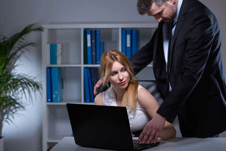 romantic sex: Adult manager and beauty secretary flirting in office