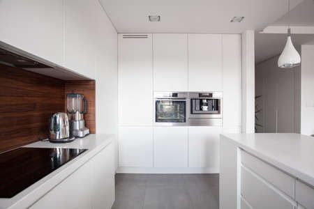 units: Elegant cozy kitchen with white units and marble floor