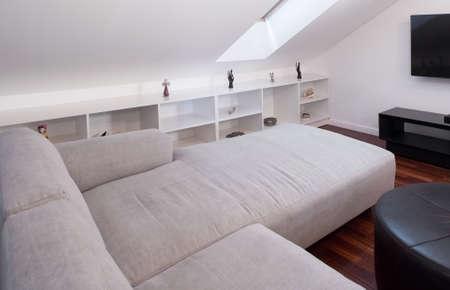 classic: Corner white sofa in room at the attic