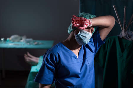 unsuccessful: Tired worried surgeon after hard unsuccessful operation Stock Photo