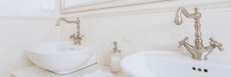 Panorama of washbasins with vintage style faucets