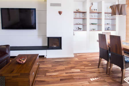 hardwood: Big wooden living room with dining table Stock Photo