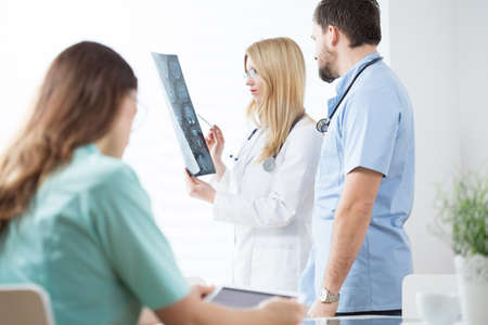 Group of doctors analysing an complicated x-ray Stock Photo