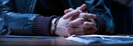 suspected: Close-up of the hands of a young man suspected