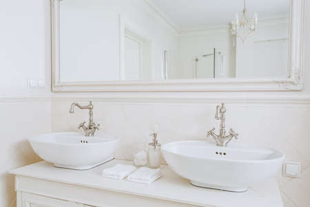 bathroom mirror: Close-up of designed washbasins in retro bathroom