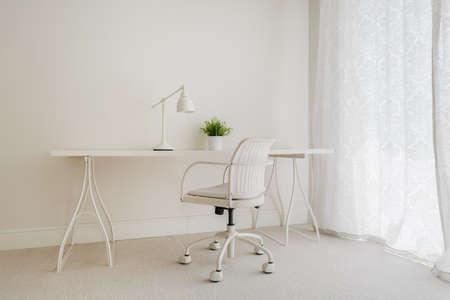 interior spaces: White retro desk in pure empty interior