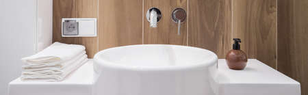 basin: Close-up of white basin and folded towels