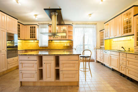 tiled stove: View of wooden cupboards in luxury kitchen