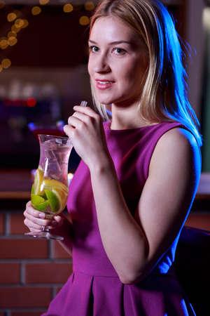 woman bar: Pretty blonde girl is having fun in the bar