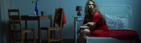 Young girl is very lonely in apartament in the night photo