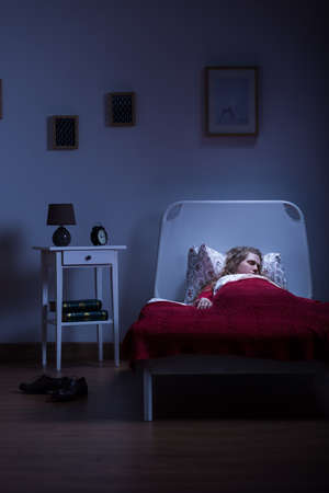 Young girl is sleeping alone in her apartament