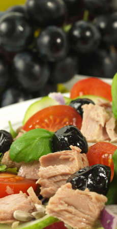 lowfat: Close-up of fresh tuna salad with olives and tomatoes