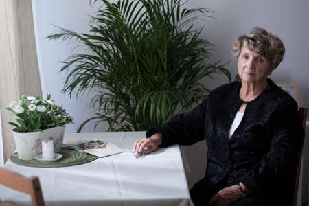 grief: Old widow is thinking about her husband