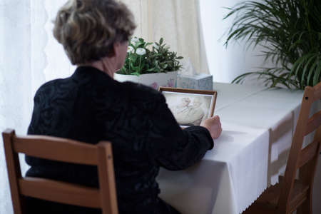 widow: Old widow remember how happy she was with her husband Stock Photo