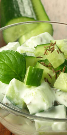 cucumber salad: Vertical photo of fresh and tasty cucumber salad Stock Photo