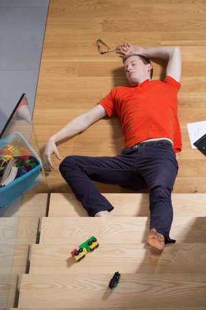 stumbling: Man lies unconsciousness after falling down from stairs