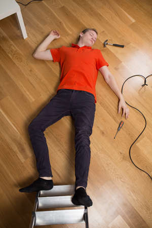 the unconscious: Unconscious man after falling from ladder Stock Photo