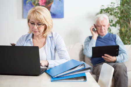 separate: Modern middle-aged people organizing their work at home