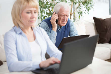 home business: Elder married couple running a business together Stock Photo