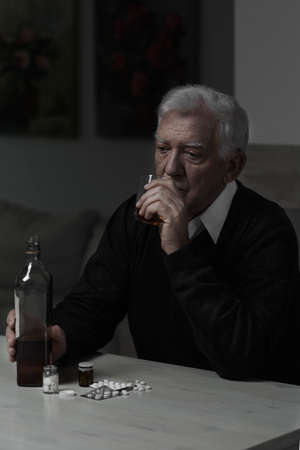abuser: Lonely old man drinking whiskey and taking pills