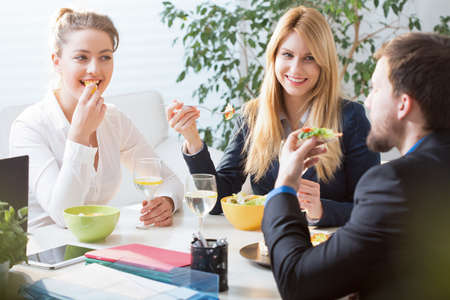 office break: Horizontal view of team eating business lunch Stock Photo