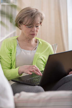 new age: Woman in middle age using new technology Stock Photo