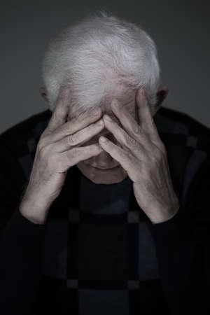 senior depression: Portrait of senior man suffering from deep depression