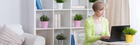 hardworking: Elder hardworking businesswoman running company at home