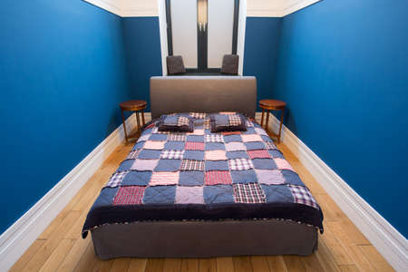 double rooms: Double bed with colorful overlay in small bedroom