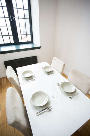 small table: White small table with four table setting