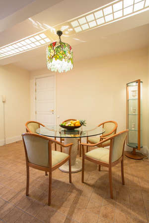 table and chairs: Elegant dining room interior with circular table