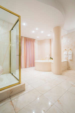 spacious: Vertical view of exclusive spacious bathroom interior