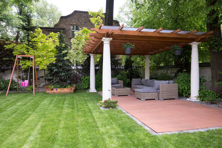 garden furniture: Picture of beauty garden with modern gazebo Stock Photo