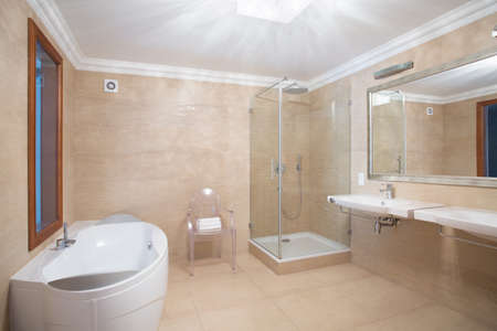 shower cubicle: Elegant spacious bathroom interior in beige colors