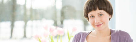 ladylike: Panoramic close-up of young smiling woman Stock Photo