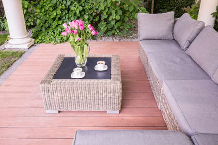 relaxing at home: Beauty summer house with wicker garden furniture Stock Photo