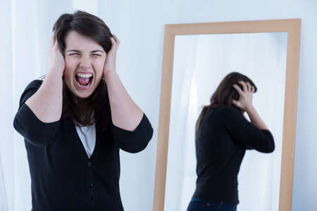 Image of young woman with problems shouting loudly 스톡 콘텐츠
