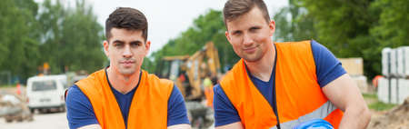 tiring: Young construction workers are muscular because of their heavy work Stock Photo