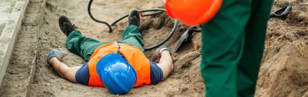 accident at work: There is an accident at the construction place Stock Photo