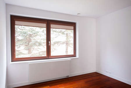 unfurnished: Big window on white wall in empty unfurnished room