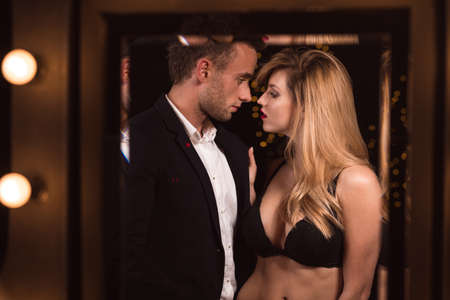 romantic sex: Image of a half naked female seducing a handsome man