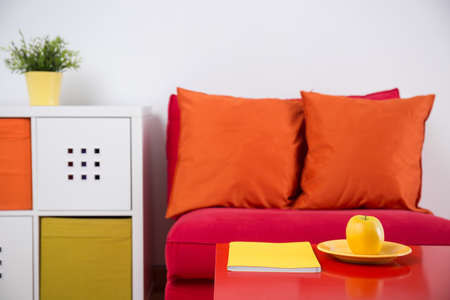 comfortable: Red comfortable armchair in colorful study room