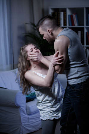 rape: Intimate partner violence, young couple fighting at home